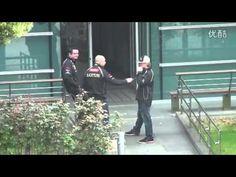 2012 ChineseGP:Kimi Räikkönen joking with his bosses Eric Boullier and Gerard Lopez