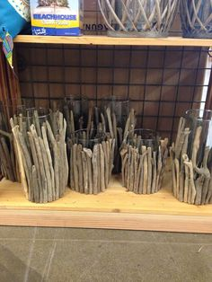 Driftwood Hurricanes make our own using the glass coffee jars and drift wood sticks we find