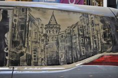 This piece invokes memories of a European city. #InkedMagazine #art #dirt #car #dirtycar #cool #Europe