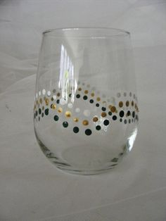 delightful - I bought a set of leopard print glasses and they rock! would hold a half bottle of wine and that is good!  hand painted wine glass  with polka dots  by DelightfulFinds, $15.00