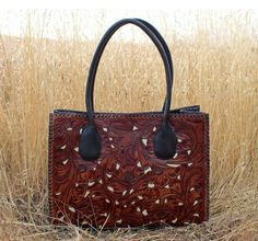 A Cowgirl's Promise LLC Store - Juan Antonio Tooled Leather Handbag Tote Saddle Brown with Ivory Inlay, $450.00 (http://www.acowgirlspromise.com/juan-antonio-tooled-leather-handbag-tote-saddle-brown-with-ivory-inlay/)