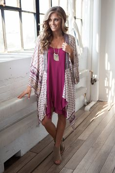 """What print dreams are made of! Shop our beyond beautiful long sleeve kimono made of 100% rayon. Front opening and neck embroidery detail. Sleeves measure 25"""". Kimono measures 46"""" from shoulder to front opening hem and measures 30"""" from shoulder to back hem. Free shipping on US orders $50 & up!"""