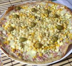 A Receita de Pizza de Frigideira é prática e fica uma delícia. A massa da pizza é fácil de fazer e fica bem crocante e saborosa. A sugestão de recheio é à