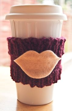 Handmade with love coffee cozy. Perfect for them cold Winter days.   This burgundy coffee cozy is perfect for them on the go coffee addicts. Lesson your impact on the environment with one of these and drink in style. Who says you only make a statement with your clothes, make a statement with a coffee cozy.