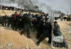 In 2006, Israeli authorities ordered the evacuation of illegal outposts, such as Amona. Oded Balilty, an Israeli photographer for the Associated Press, was present when the evacuation degenerated into violent and unprecedented clashes between settlers and police officers. The picture shows a brave woman rebelling against authorities.