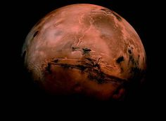 Valles Marineris on Mars - The canyon stretches 2,485 miles across the planets surface and reaches depths of 6.2 miles