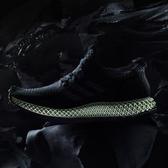 """Adidas has unveiled trainers with latticed plastic midsoles, which are shaped using a new technique that """"overcomes shortcomings"""" of 3D printing."""