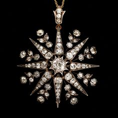 A magnificent Victorian Star pendant, set with a little under 6 carats of old cut diamonds. The star comprises eight points around a central one carat stone, with leaf and flower motifs between each point. Complete with the original diamond-set bail, the piece dates to the 1870s.