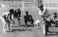 Members of the West Indian cricket team field as Geoff Hurst tries his hand at batting a football at Chelsea's Stamford Bridge ground, London, July 23 1980. Fielding are (left to right) Derek Murray, Clyde Walcott, Viv Richards and Alvin Kallicharran