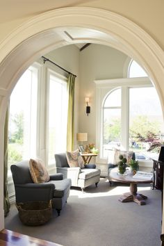 beautiful archway leading into a bright living room