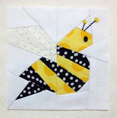 Bee -- The little glitter on the wings is golden embroidery thread, there was no problem when ironing it.