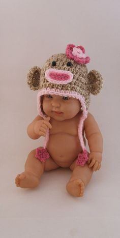 crochet monkey hat -- weird its on a doll ha but sooo cute for a baby girl! Gotta make this!!