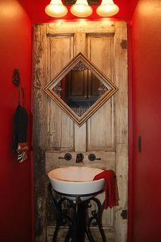 awesome door repurpose - so cool to put the faucet in the door