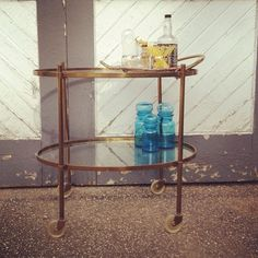2 tier Brass and Glass Oval rolling Bar Cart. very mad men style $699
