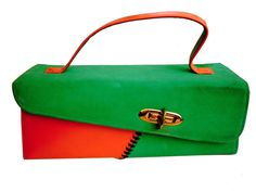 1950s slightly trapezoid bright orange leather and bright green suede box purse with black lacing, off-center closure, orange handle and green lining with attached snap change purse and separate mirror by Stylecraft-Miami.