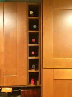 If the diswasher leaves extra space once we take out the double cabinet, a  vertical winerack is the Best. Ikea Hackers ...