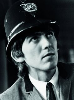 """George wears a """"bobby"""" hat of the West Midlands Police at the HIppodrome Theater, Birmingham UK November 10,1963 Photo by Ringo Starr"""