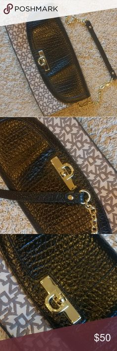 New DKNY brown monogram flap bag DKNY brown monogram flap bag with gold hardware. New without tag, never worn and no scratches. Inside intact, one inside zip pocket. No stains or damage. Chain shoulder strap. Beautiful brown color, great look. Dkny Bags