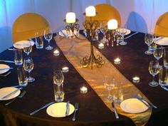 Black table cloth & gold chairs