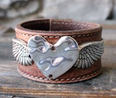 Ever Designs Jewelry - Angel Wing Leather Cuff, $55.00 (http://www.everdesigns.com/angel-wing-leather-cuff/)