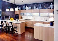 Wallpaper is a great choice for disguising that awkward space above your cabinets.