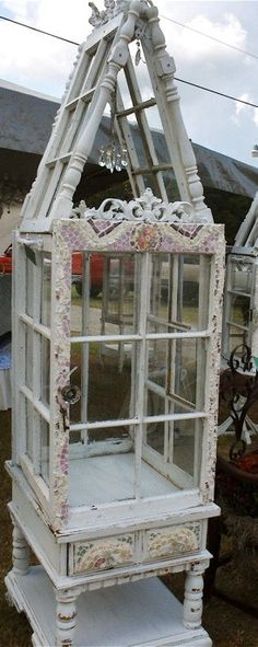 Victorian style, whimsical garden conservatories from recycled elements. Each of her creations are composed of old windows, unique vintage china mosaics, small side tables and architectural elements like corbels and table legs and glass doorknobs. Repurposed Furniture, Painted Furniture, Diy Furniture, Repurposed Shutters, Furniture Design, Backyard Furniture, Handmade Furniture, Old Windows, Windows And Doors