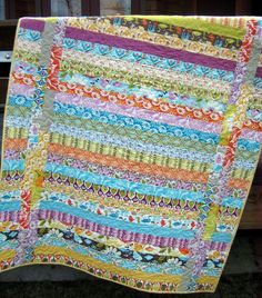 Strip Quilt Using One Jelly Roll  Finishes 49X64