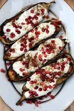 Roasted Eggplant with Yogurt and Pomegranate 2 large and long aubergines 75ml olive oil Coarse sea salt and freshly ground black pepper 1 pomegranate 1 tsp za'atar A few sprigs fresh lemon thyme For the sauce 140ml buttermilk 100g Greek yogurt 1½ tbsp olive oil, plus a drizzle to finish off 1 small garlic clove, crushed Pinch salt