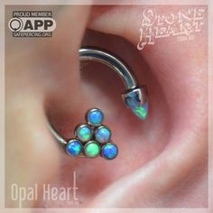 "Myyyyyy daiths  bring all the boys to the yard, they're like 'its better than yours' - damn right its better than yours! I could pierce you, but I'd have to chargeeeee.  12g 7/16"" Daith featuring @anatometalinc customized cluster and bullet opal cabachon.  #opalheartpiercing #stoneheartbodyart #appmember #safepiercing  (at Stone Heart Body Art)"