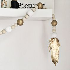 So much love for this gold metallic wooden beaded pom pom garland finishing in a faux leather gold feather. These look beautiful hanging from mirrors, shelves, from curtain poles- wherever you fancy adding a bit of pretty. They look amazing by themselves or dangling along a display on a shelf. They are also perfect for product flat lays so a great buy as a prop for people who love photographing items for Instagram. The beads are hand painted and strung on strong waxed cotton cord. They end…