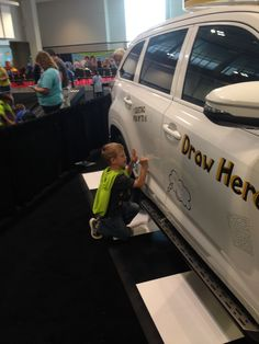 Showgoers were able to draw on a car - yes, it's true - thanks to Toyota, sponsor of the Race Ramps.