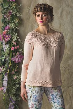 The Celosia Pullover is made especially for spring, with its open lace yoke and lightweight cotton-silk yarn. The sweater is worked seamlessly from the top down, and yoke increases are worked into the lace and traveling-stitch pattern. A second lace patte