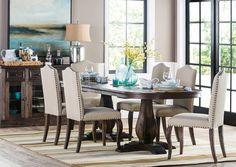 Dark wood buffet, dark wood table, light fabric chairs