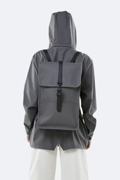 Backpack is a true RAINS classic made from a water-resistant fabric with a matte finish. Fully lined, this minimalistic yet modern rucksack has an Rains Backpack, Backpack Online, Rubber Raincoats, Men's Backpacks, Waterproof Backpack, Wet Weather, Rain Wear, Fabric Material