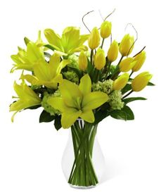 Bright yellow #tulips and #lilies