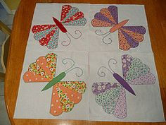 butterfly appliqué quilt block with Dresden wings