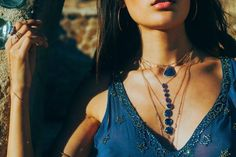 The important thing to remember when layering necklaces is to be sure the necklaces are all different lengths. This look incorporates three necklaces with the same stone so the look is more cohesive