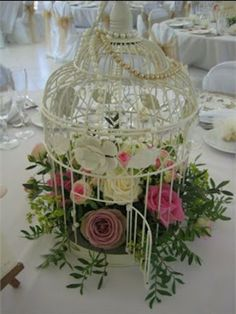 Birdcage centrepiece. What a genius idea!