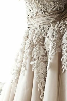 Lace detailing on wedding dress by riczkho
