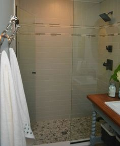 River rock shower floor MODERN COTTAGE BATHROOM RENOVATION