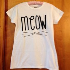 "NWOT ""MEOW"" graphic tee shirt size XL This graphic tee is made from 100% cotton. This tee is white with black graphics. Underarm to underarm 19 inches. Shoulder to bottom of tee 26 1/2 inches Tops Tees - Short Sleeve"