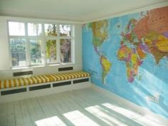 Wall map--maybe a little more fun, but the same concept :) My kids are going to know geography gosh darn it!