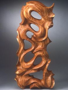 "Escher Tide : This wall sculpture is named in his honor and sculpted with the intention of capturing the essence of Escher's work in three dimensions. Have fun with it!Escher Tide | 2'-4"" h, 1'-0"" w, 2"" diameter 