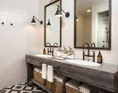 #Farmhouse at its finest! A jaw-dropping #reclaimedwood #vanity is beautifully complemented by #subwaytile on the walls and #cementtile on the floors. This one goes to my #wishlist. :) #farmhouseinteriors #farmhousebathroom #bathrooms #rusticinteriors #rustic #lighting #storageideas #mirror #mydomaine #houses #farmhouseideas #goals #farmhousegoals #farmhouseinspo #inspo #iggoals #inspobathroom @tiffanyfarhadesign