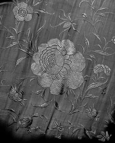 Shawl (detail). Chinese, 1885–1910. White silk crepe embroidered with white silk. Brooklyn Museum Costume Collection at The Metropolitan Museum of Art, Gift of the Brooklyn Museum, 2009; Gift of Alastair Bradley Martin, 1965 (2009.300.7429)   Photography © Platon #ChinaLookingGlass #AsianArt100