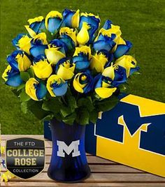 FTD presents the University of Michigan Wolverines Rose Bouquet and gifts. Show school pride with this rose bouquet, available with an etched keepsake vase. West Virginia University, University Of Michigan, Michigan Go Blue, Michigan Game, Michigan Colors, Michigan Wolverines Football, Go Big Blue, Blue Roses, Rose Bouquet