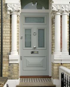 Substantial pale grey Edwardian door with opaque glazing and polished chrome door furniture. The front door of this grand townhouse sits beautifully behind its whitewashed stone columns. Victorian Front Doors, Grey Front Doors, Front Door Porch, Porch Doors, House Front Door, Front Door Colors, Glass Front Door, House Entrance, Exterior Doors With Glass