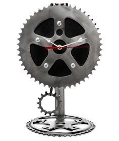 RECYCLED DESK PENDULUM CLOCK  $76.00  Graham Bergh and his team of gifted artisans go the extra mile to bring you funky fun: Each month they collect bicycle parts, donate those that still have life and transform others into clever creations like this pendulum clock handmade from bicycle chains and cogs. Set it on a desk or anywhere in your home for a distinct accent with many miles of history behind it. Handmade in Oregon.