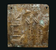 Urartian Bronze Votive Plaque, c. 8th-7th century BC Of hammered sheet bronze, probably depicting the storm god, Teisheba, enthroned wearing a long cloak and sun disc crown, holding three thunderbolts...