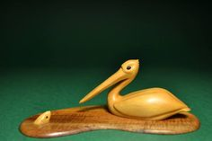 Pelican's Lunch in Huon Pine & Sapele. https://www.facebook.com/pages/Germaine-Keys-Wood-CarvingSculpture/555106897954457?ref=hl